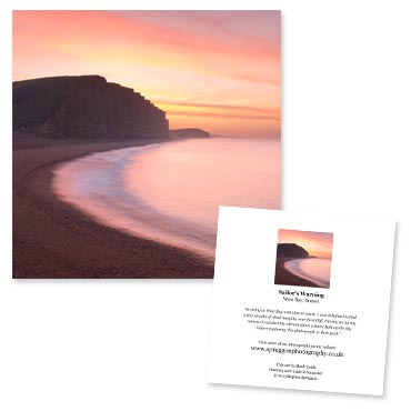 'Sailor's Warning' large greeting card featuring a dramatic red sunrise over East Cliff, West Bay, Dorset.