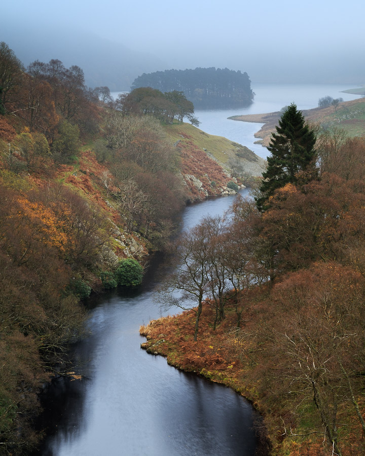 Late autumn colours surrounding the Afon Elan as it flows into Penygarreg Reservoir in the Elan Valley, Powys, Wales, UK. Image © Stephen Spraggon.