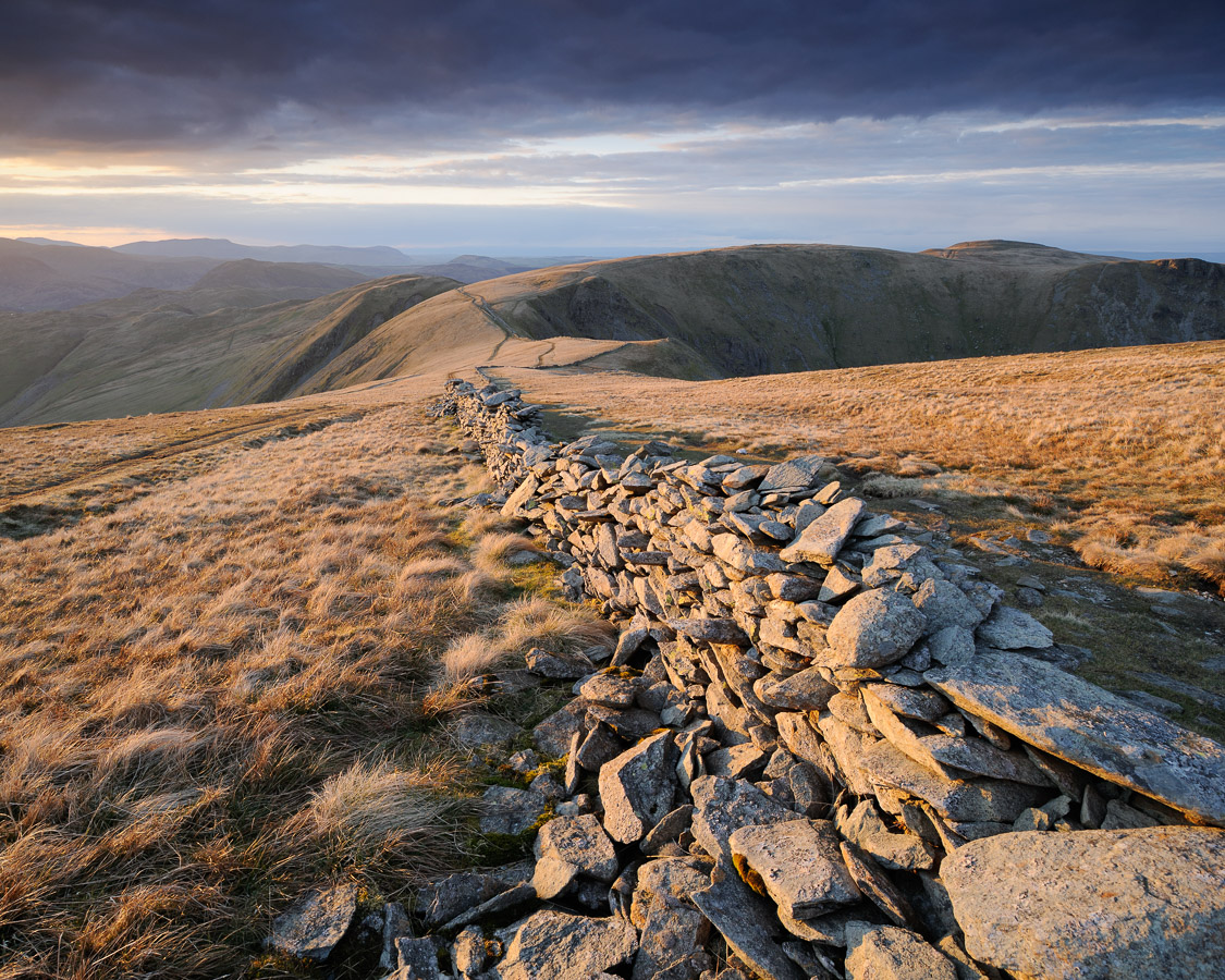 Crisp light from the setting sun hitting the drystone wall that runs along High Street, a fell in the Lake District, UK. Image © Stephen Spraggon.