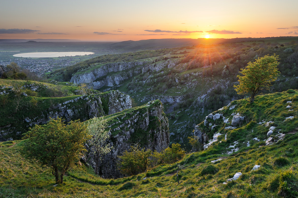 A vibrant spring sunset photographed from the Pinnacles at the top of Cheddar Gorge, Somerset, UK. Image © Stephen Spraggon.