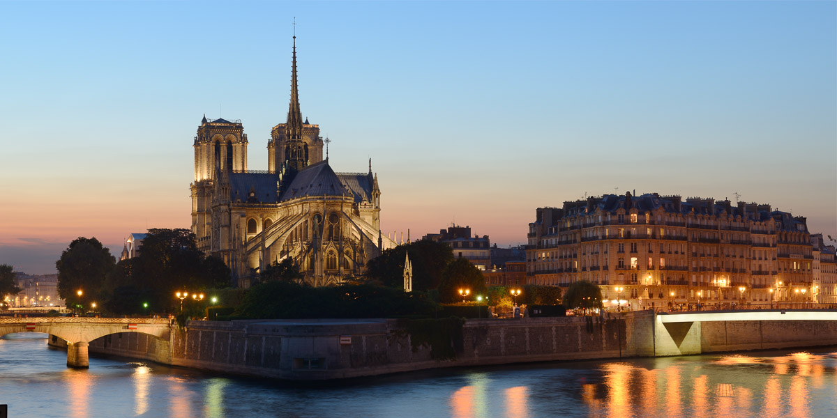 The Notre-Dame Cathedral illuminated at dusk. Paris, France. Image © Stephen Spraggon.