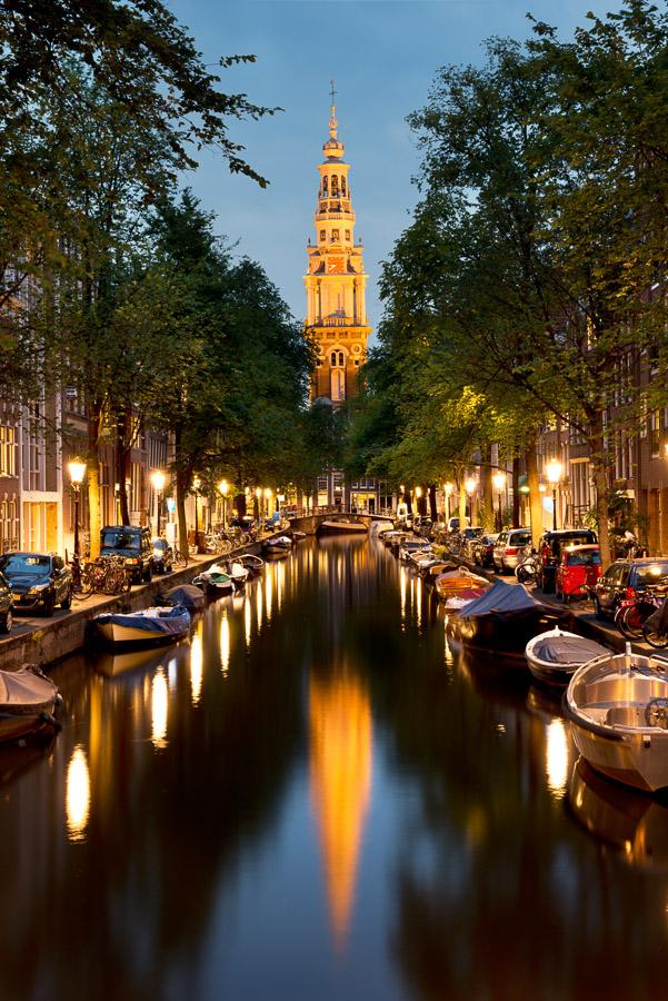The Zuiderkerk, a famous 17th Century Protestant church in the Nieuwmarkt area of Amsterdam, The Netherlands, illuminated at dusk. Image © Stephen Spraggon.
