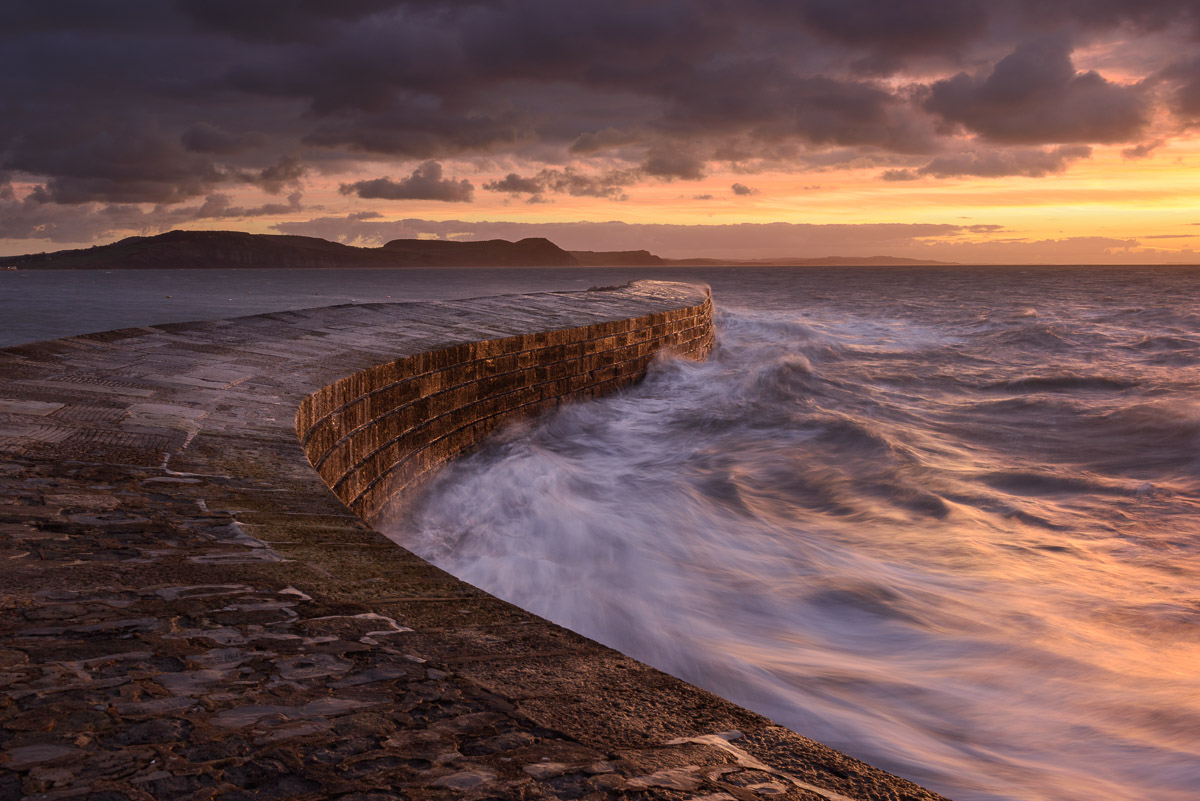 A fiery sunrise over the Cobb at Lyme Regis, Dorset. Image © Stephen Spraggon.