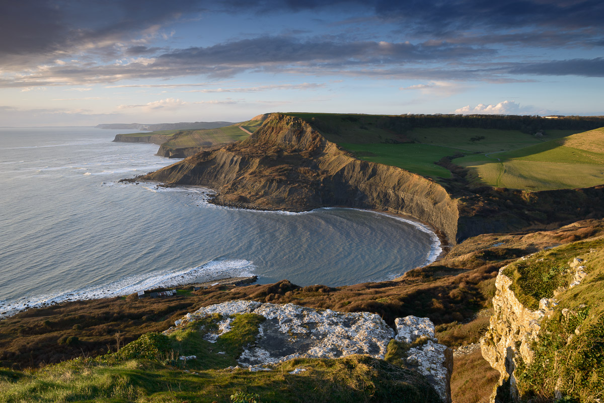 Chapman's Pool and Houns-tout Cliff with the Jurassic coastline stretching into the distance, seen from Emmett's Hill, Dorset. Image © Stephen Spraggon.