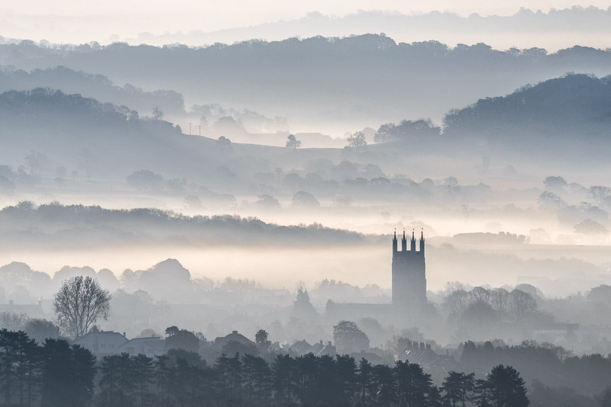 A misty morning on the Somerset Levels with St Cuthbert's Church, Wells, clearly visible. Image © Stephen Spraggon.