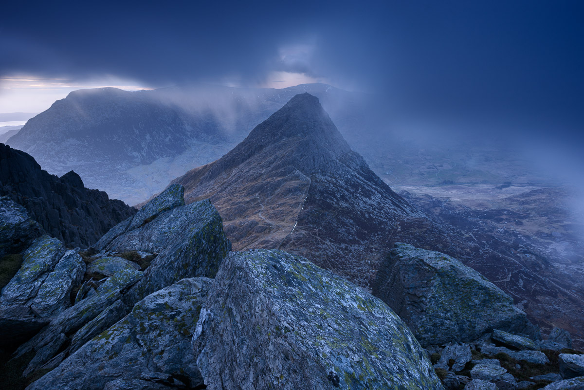 Tryfan surrounded by low cloud at dusk in the Glyder Mountains, Snowdonia. Image © Stephen Spraggon.