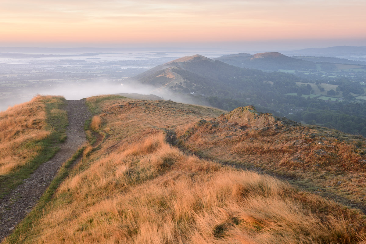 A misty sunrise photographed from Worcestershire beacon, looking south in the Malvern Hills. Image © Stephen Spraggon.
