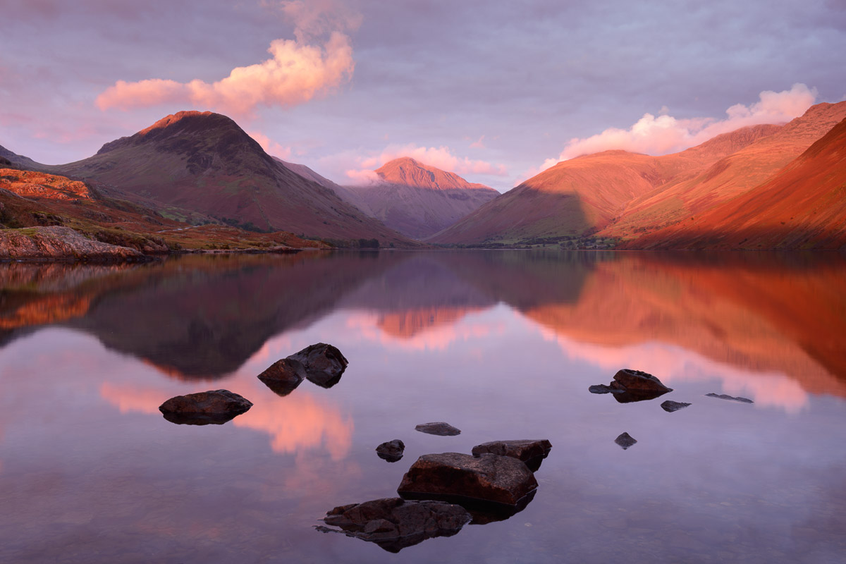 Intense red light from sunset hits the peaks of Yewbarrow, Great Gable and Lingmell on an autumn afternoon at Wast Water in the Lake District. Image © Stephen Spraggon.
