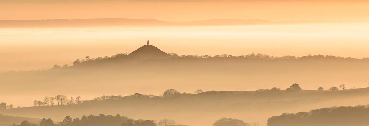 Glastonbury Tor looming above a sea of mist on the Somerset Levels during a brilliant autumn sunset. Image © Stephen Spraggon.