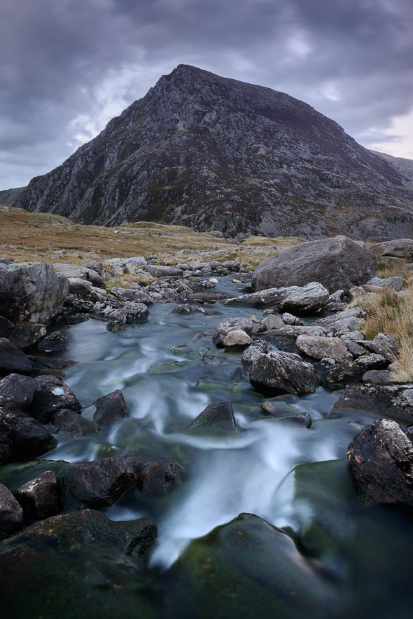 The triangular shape of Pen Yr Ole Wen rises above the river Idwal in the Ogwen Valley, Snowdonia. Image © Stephen Spraggon.
