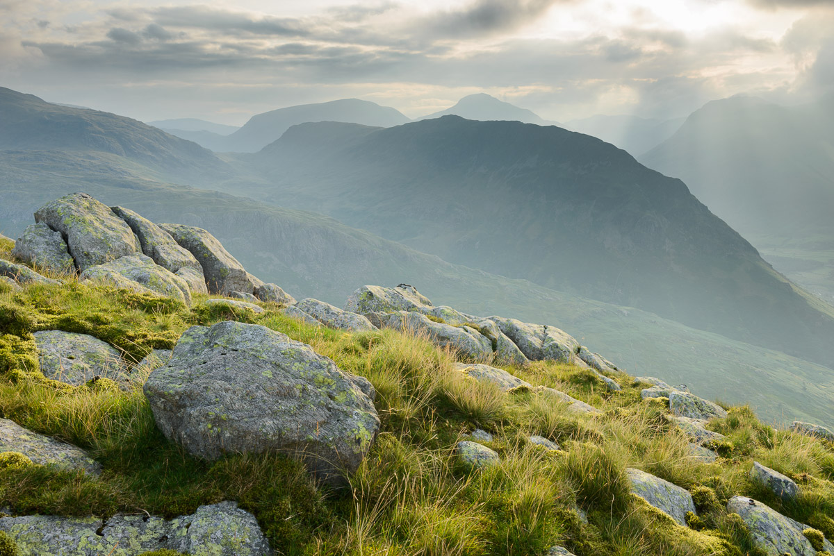 A hazy view towards Yewbarrow and Great Gable from Middle Fell in the Lake District. Image © Stephen Spraggon.