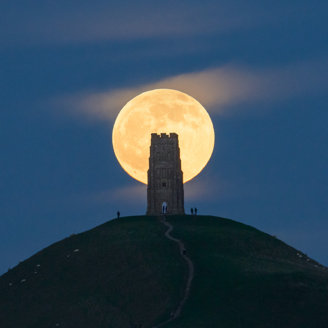 A 'Wolf moon', the first full moon of 2020, rising behind Glastonbury Tor, Somerset, on 10th January 2020. Image © Stephen Spraggon.