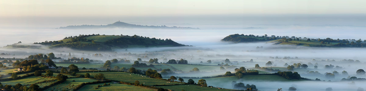 The Somerset Levels shrouded in fog on an autumn morning. Glastonbury Tor is clearly visible on the horizon. Image © Stephen Spraggon.